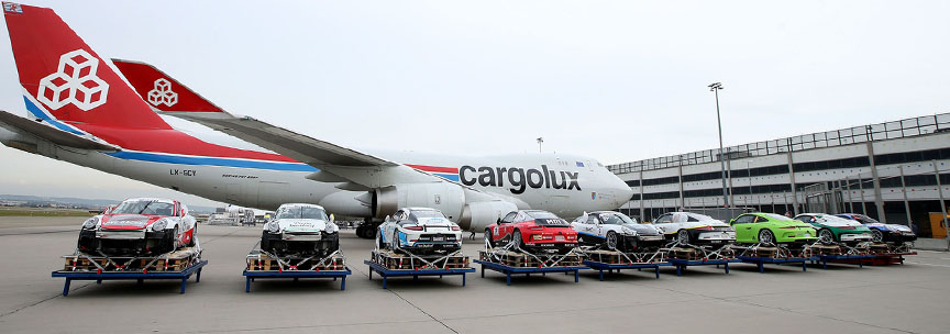 Porsche 911 GT3 Cup cars packed into the jumbo cargo jet