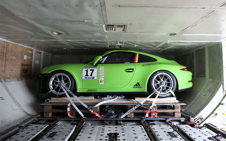 Porsche 911 GT3 Cup car packed into the jumbo cargo jet