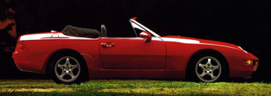 Red Porsche 968 convertible side view