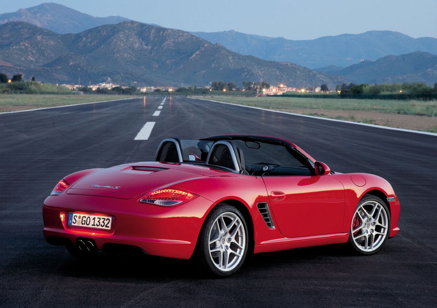 Guards Red Porsche Boxster S (987 facelifft) on an airstrip