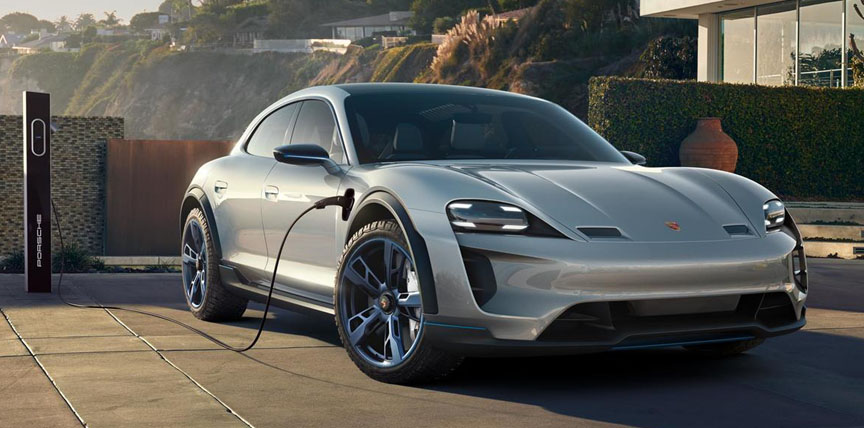 Porsche Mission E Cross Turismo concept car connected to a charger