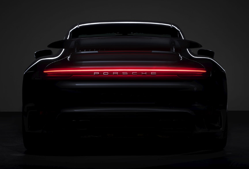 Porsche 911 992 Turbo S rear view in the dark