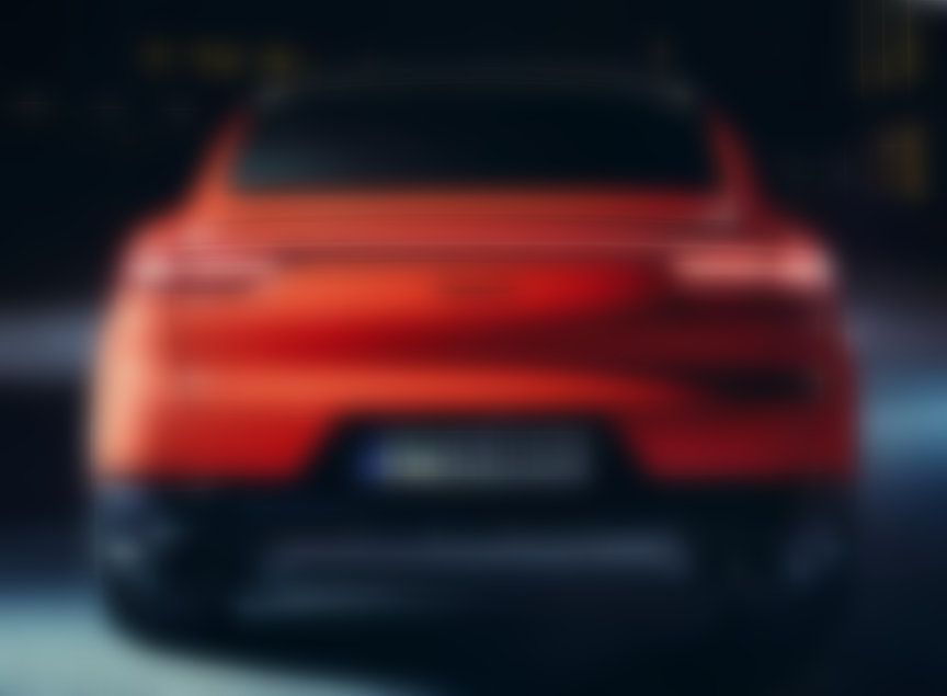 Rear view of 2019/2020 Porsche Cayenne Coupe in Lava Orange