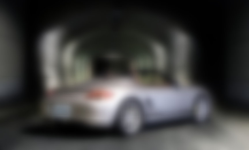 Silver Porsche Boxster 987 Spyder posing in the tunnel