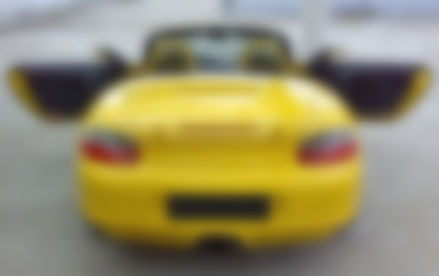 Yellow Porsche Boxster S 986.2 with aerokit