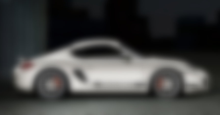 White Porsche Cayman R, side view