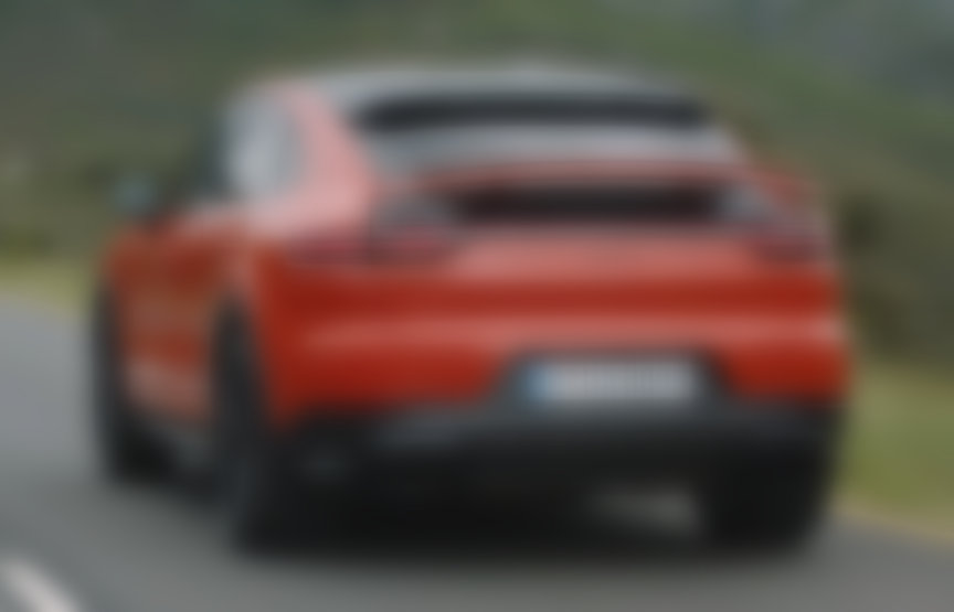 2019/2020 Lava Orange Porsche Cayenne Coupe with rear spoiler up