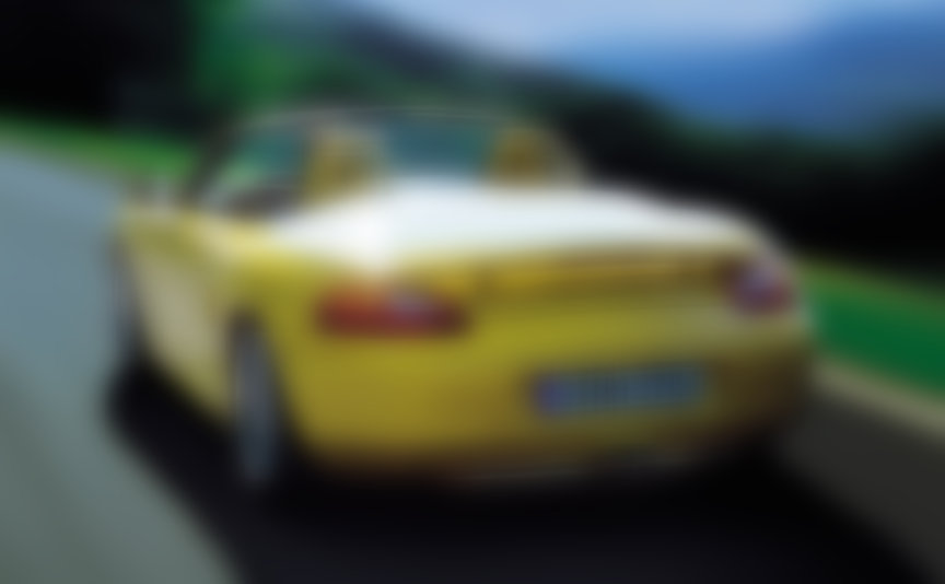Yellow Porsche Boxster 986 S with fixed rear spoiler